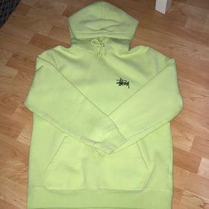 Bright mint green Stussy hoodie
